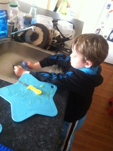 Washing up...great to learn to clean what we use (his future wife will thank me!)
